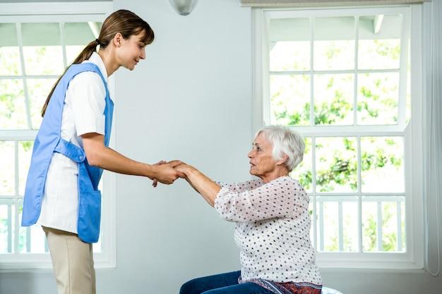 Nurse assisting senior woman