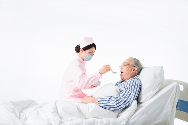 Nurse caring for the elderly to eat