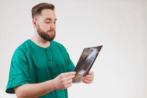 Nurse checking x ray scan