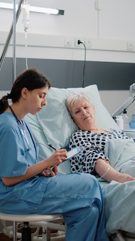 Nurse doing consultation with sick woman for healthcare