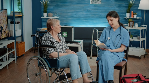 Nurse giving assistance to retired woman in nursing home