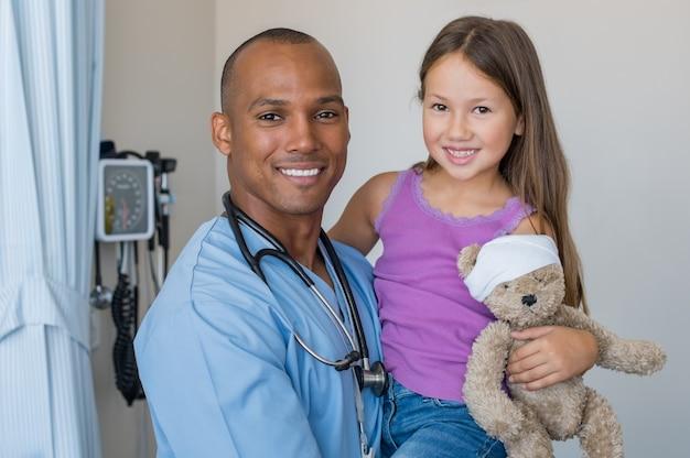 Nurse holding child