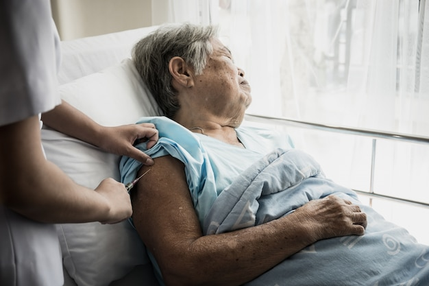 Nurse injections for elderly patients admitted to hospital.