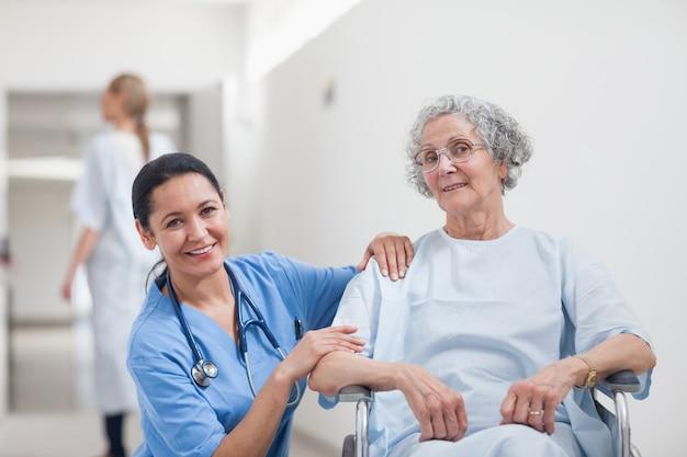 Nurse and patient smiling