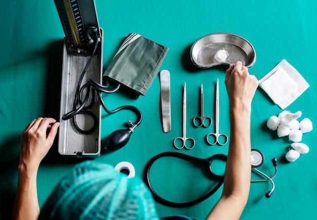 Nurse preparing medical equipment for surgery