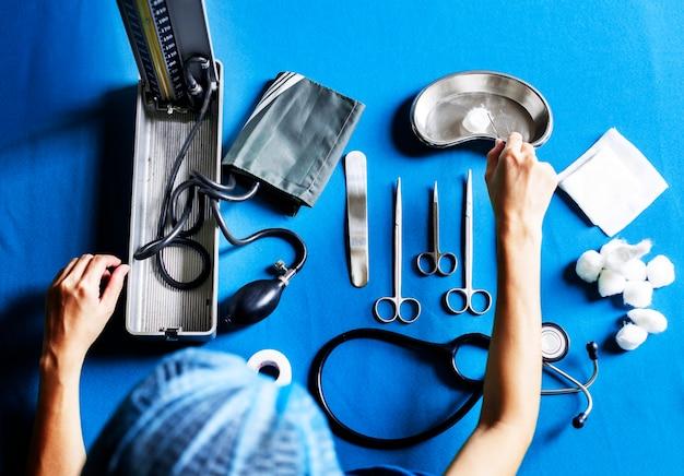 Nurse preparing medical equipment