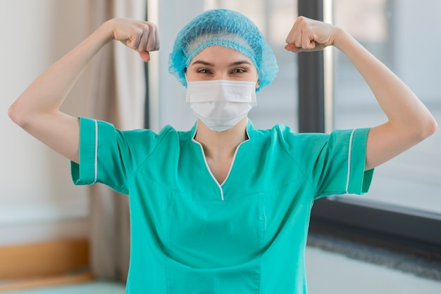 Nurse showing muscles