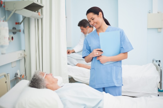 Nurse smiling to a patient