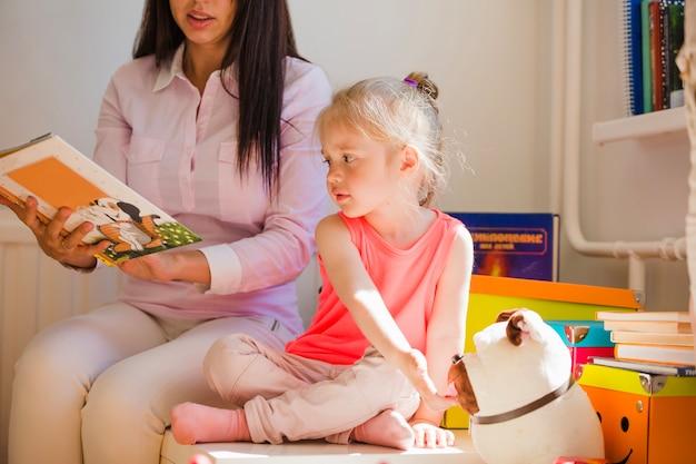 Nurse storytelling to girl