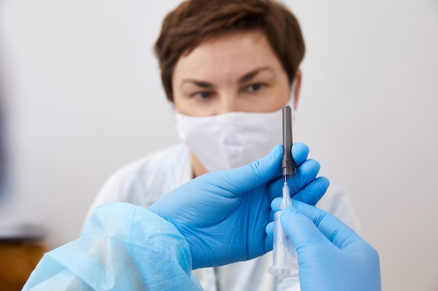 Nurse taking blood sample to make a test in laboratory