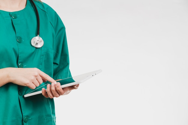 Nurse with tablet and stethoscope