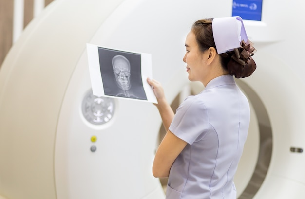 The nurse and x-ray skull image in ct scan room