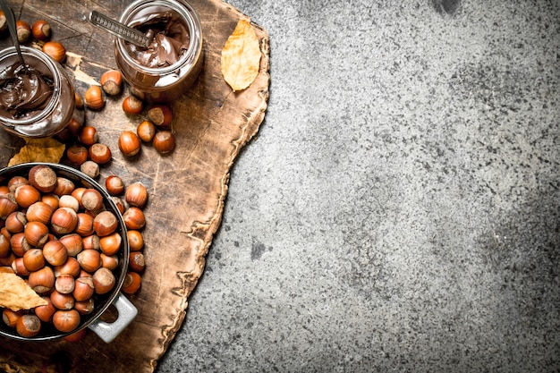 Nut butter from hazelnuts and chocolate on rustic background
