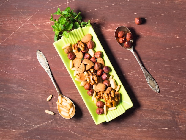 Nut mix on green dish