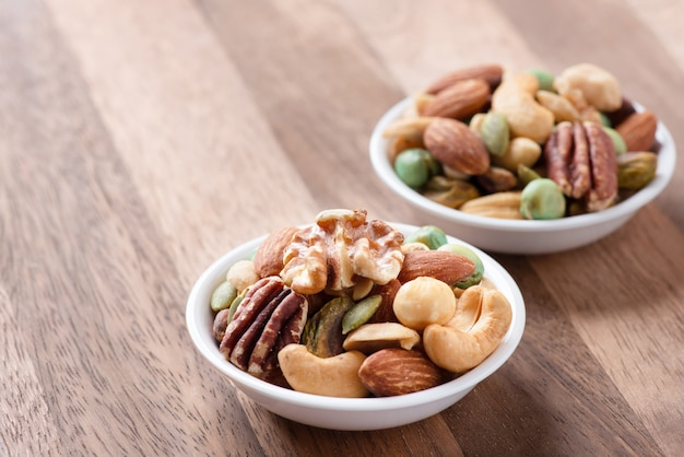 Nut mix on plate, assorted and various of nuts healthy diet.
