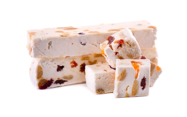 Nut nougat with dried fruit, sweet candy isolated on white space