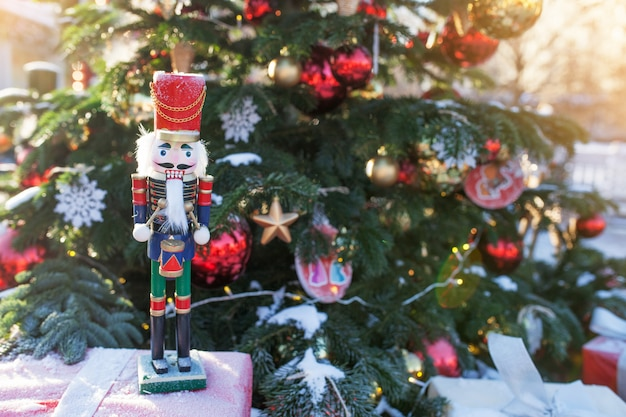 Nutcracker at christmas market  in winter moscow, russia. advent decoration and fir tree with crafts gifts on the bazaar. street xmas holiday in europa. christmas decoration on city street