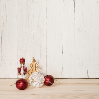 Nutcracker with christmas ornaments and copy space