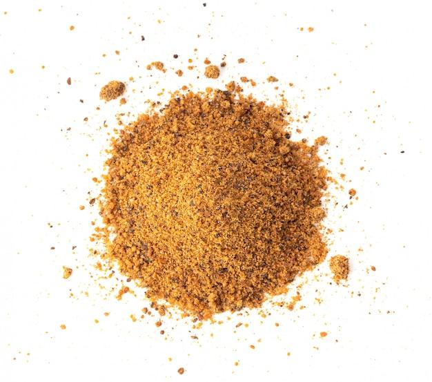 Nutmeg powder on white