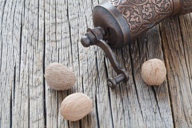 Nutmeg whole  on wooden, selective focus