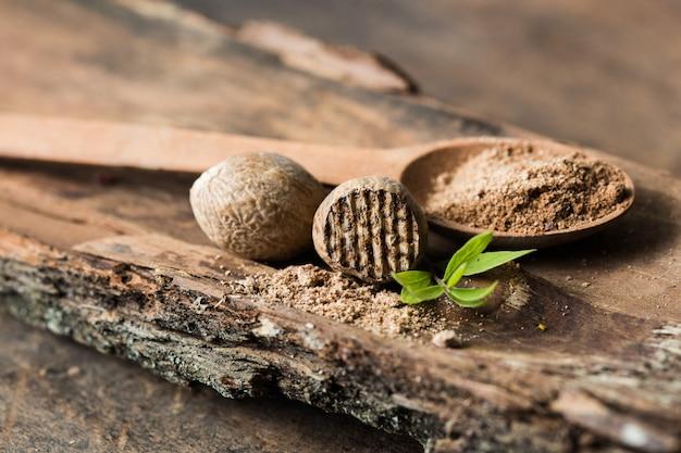Nutmegs and ground nutmeg on a spoon