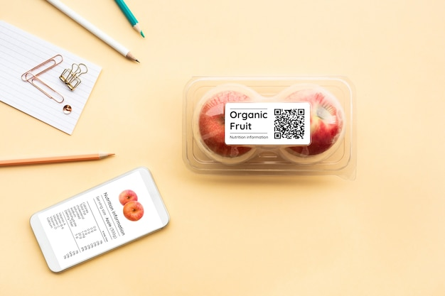 Nutrition information of organic fruit with apple in packaging and qr code, flat lay