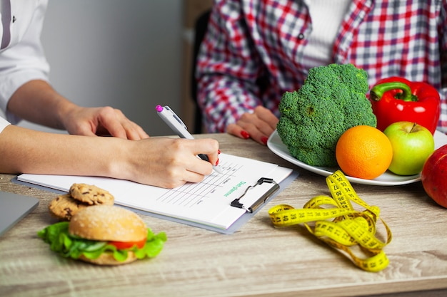 Nutritionist prepares a diet plan for an overweight woman