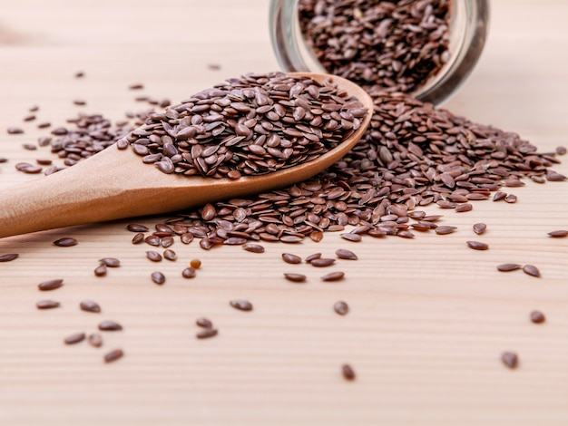 Nutritious flax seeds setup on wooden background