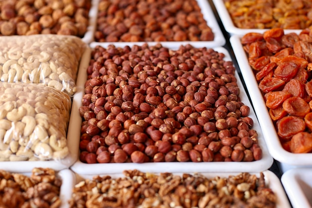 Nuts and dried fruits, on the market counter.