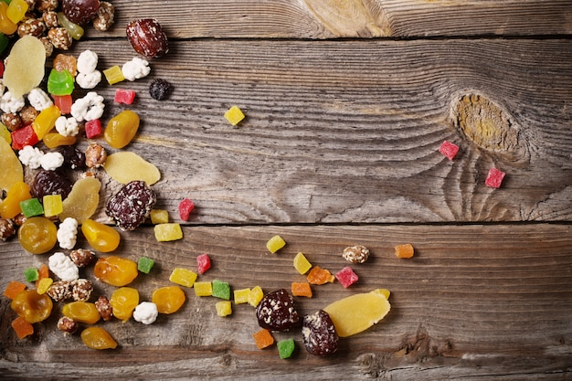 Nuts and dried fruits mix on wooden background