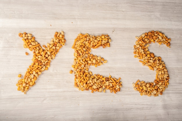 Nuts making words of yes or no, snack for between hours