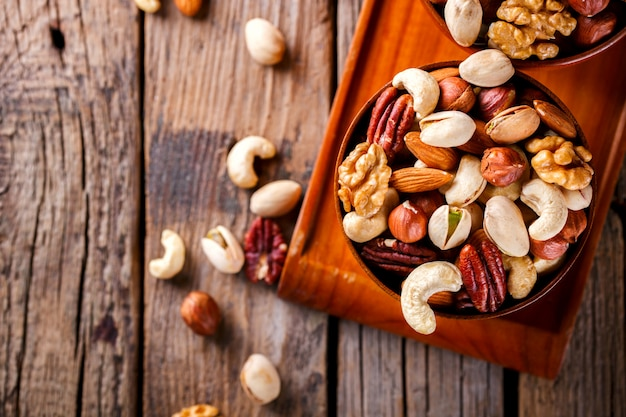 Nuts mixed in a wooden plate.assortment