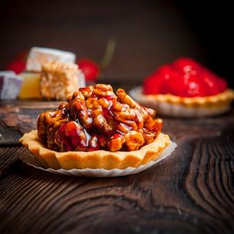 Nuts pie tarts with strawberry pie tarts