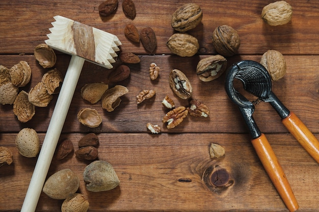 Nuts, steak hammer and nutcracker