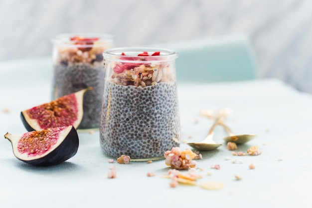 Nuts topping on chia's smoothie in transparent jar