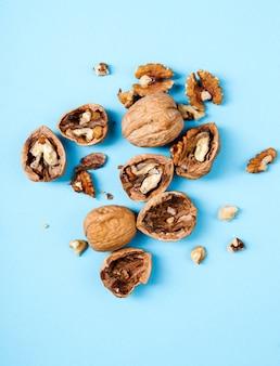 Nuts. walnuts on a blue background
