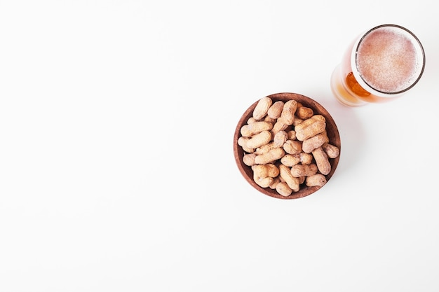 Nuts with beer on white.