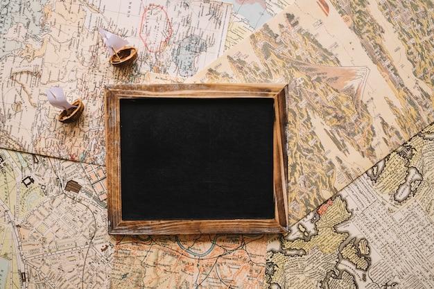 Nutshell boats and blackboard on maps