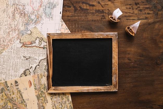 Nutshell boats and maps near blackboard
