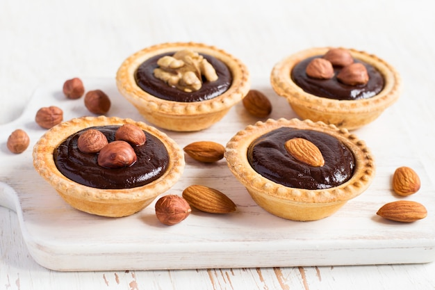 Nutty dessert - small tarts with different nuts and chocolate