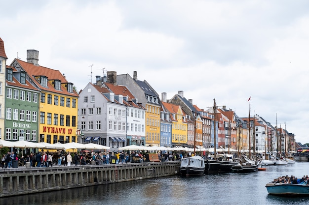 Nyhavn, copenhagen/denmark, very popular and famous for tourist tourism landmark in europe.