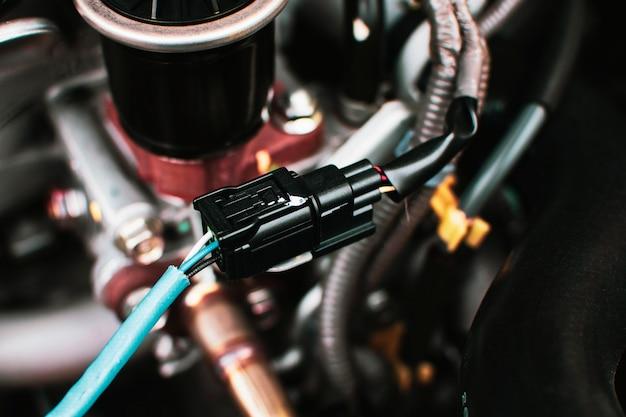 Разъем провода электрического разъема к датчику кислорода автомобиля o2 системы двигателя, концепции автомобильной части.