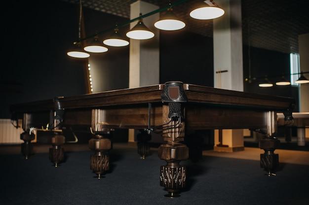 Oak unusual billiard table in a billiard club.bottom view.