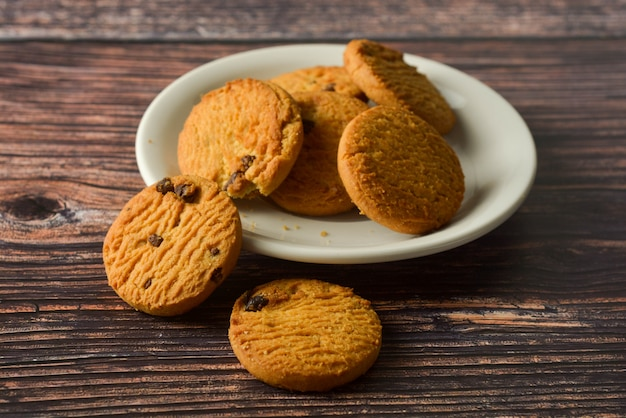 Oat and chocolate chip cookies on rustic wooden table