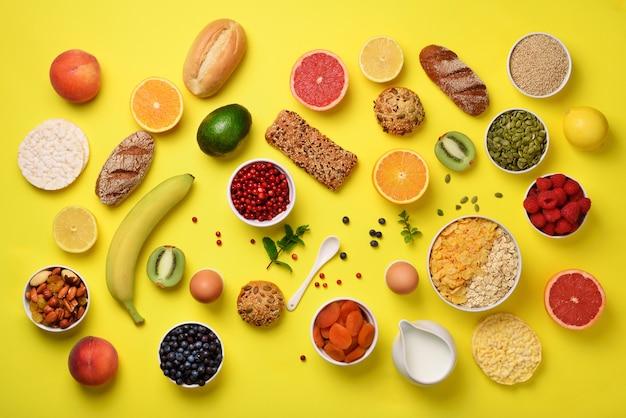 Oat and corn flakes, eggs, nuts, fruits, berries, toast, milk, yogurt, orange, banana, peach