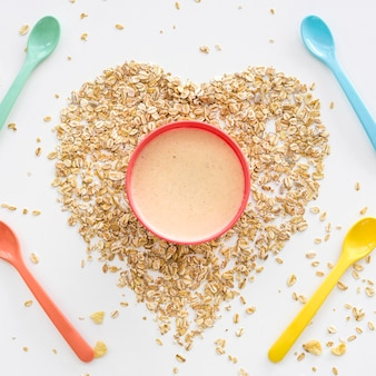 Oat flakes in heart shape and milk