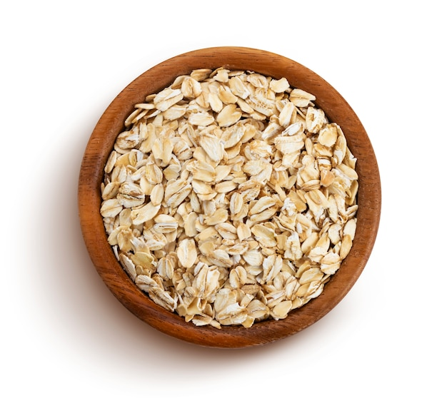 Oat flakes isolated, top view