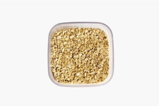 Oat flakes in plastic can isolated on white background