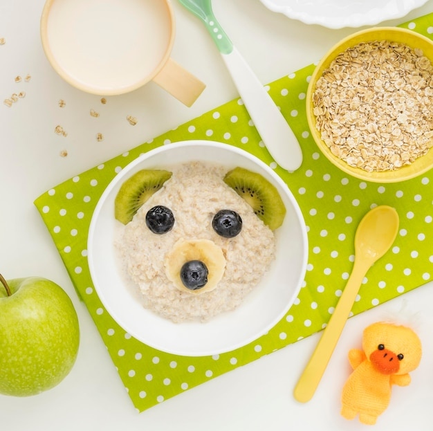 Oat flakes with milk baby food