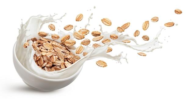 Oat flakes with milk splashes isolated on white background